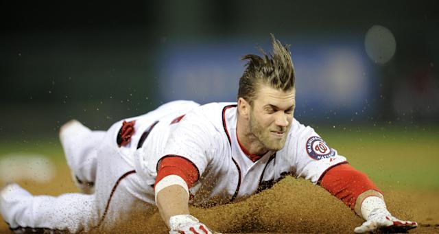 Bryce Harper injured his thumb in April while sliding head first. (AP)