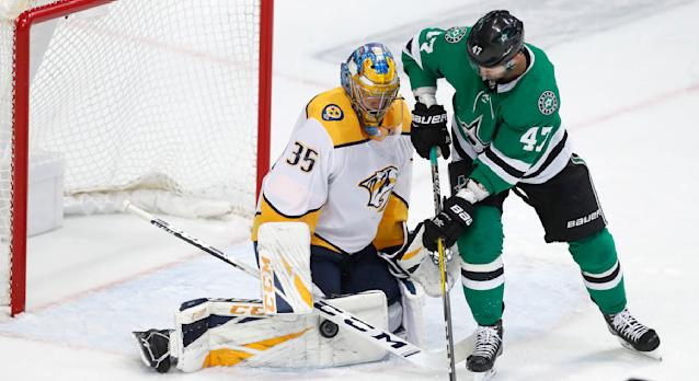 Nashville Predators goaltender Pekka Rinne (35) defends the goal against Dallas Stars right wing Alexander Radulov (47) during the first period of an NHL hockey game in Dallas, Tuesday, Feb. 19, 2019. (AP Photo/LM Otero)