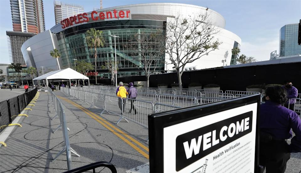 A slow trickle of fans head toward the Staples Center entrance for the Lakers-Celtics game on Thursday.