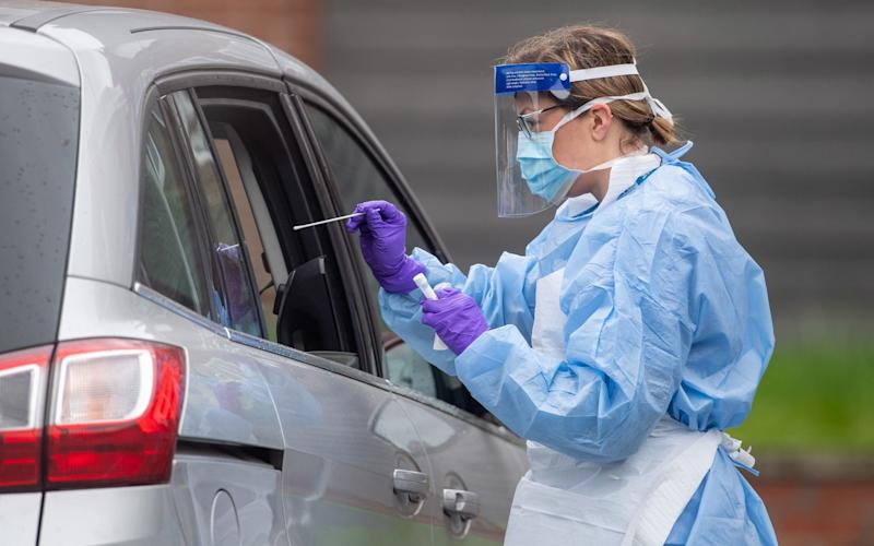 HS staff carry out Coronavirus tests at a testing facility in Bracebridge Heath, Lincoln - PA