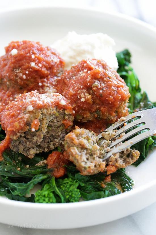 """<div><span>Per 3-meatball-serving</span>: 295 calories, 11 g fat (3.6 g saturated), 494 mg sodium, 18 g carbs, 1 g fiber, 7 g sugar, 27 g protein</div> At ETNT we love <a rel=""""nofollow noopener"""" href=""""https://www.eatthis.com/healthy-crock-pot-recipes?utm_source=yahoo-news&utm_medium=feed&utm_campaign=yahoo-feed"""" target=""""_blank"""" data-ylk=""""slk:healthy crock pot recipes"""" class=""""link rapid-noclick-resp"""">healthy crock pot recipes</a>. There's nothing better than tossing ingredients into a slow cooker, turning up the heat and coming back hours later to a perfectly cooked, wholesome meal. This one gives you steaming plates of tender meatballs and fresh tomato sauce over broccoli rabe — not to mention a slimming nutritional profile. <strong>Get the recipe from <a rel=""""nofollow noopener"""" href=""""http://www.skinnytaste.com/slow-cooker-beef-meatballs-with-broccoli-rabe/"""" target=""""_blank"""" data-ylk=""""slk:Skinny Taste"""" class=""""link rapid-noclick-resp"""">Skinny Taste</a>.</strong>"""