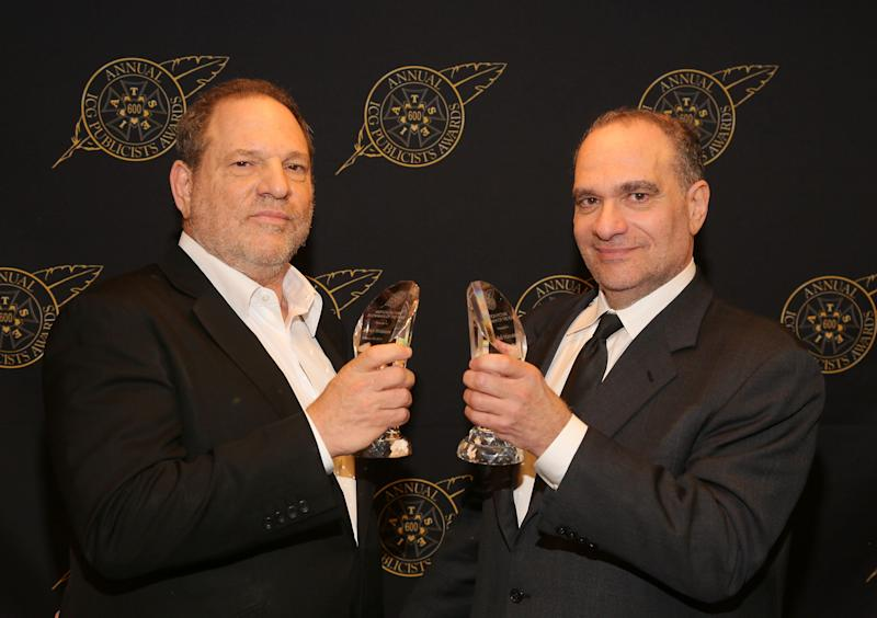 Harvey and Bob Weinstein pose with the Motion Picture Showmanship Award backstage at The Beverly Hilton hotel on Feb. 20, 2015.