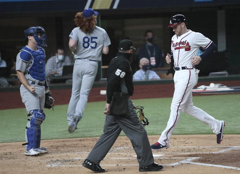 Atlanta's Freddie Freeman scores on a sacrifice fly in the first inning.