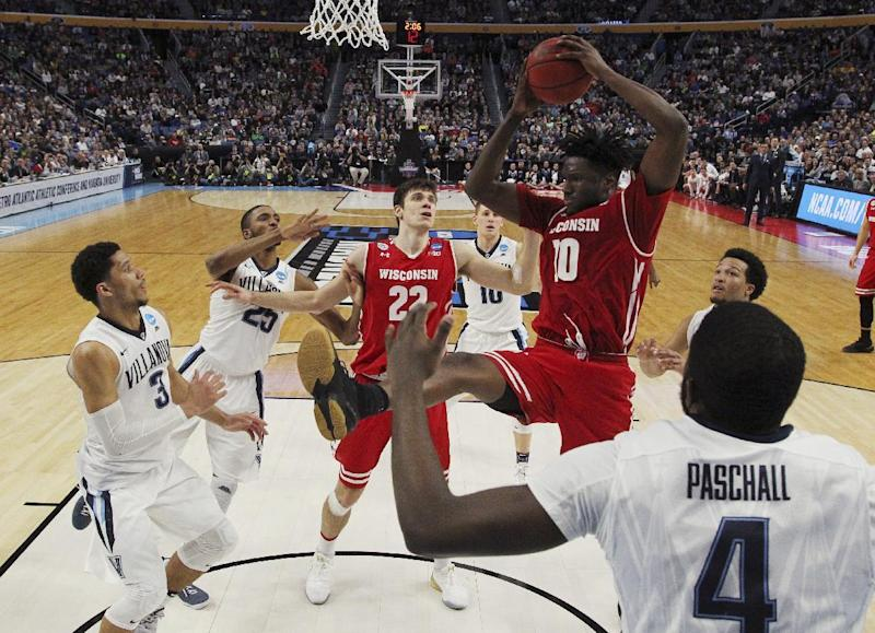 Wisconsin forward Nigel Hayes (10) grabs a rebound against Villanova guard Josh Hart (3) and Eric Paschall, right, during the second half of a second-round game in the NCAA men's college basketball tournament, Saturday, March 18, 2017, in Buffalo, N.Y. Wisconsin won 65-62. (AP Photo/Bill Wippert)