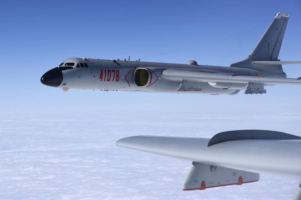 In this Nov. 23, 2017, photo released by Xinhua News Agency, a Chinese military H-6K bomber is seen conducting training exercises, as the People's Liberation Army (PLA) air force conducted a combat air patrol in the South China Sea. With record numbers of military flights near Taiwan over the last week, China has been stepping up its harassment of the island it claims as its own, showing an new intensity and sophistication as it asserts its territorial claims in the region. (Wang Guosong/Xinhua via AP)