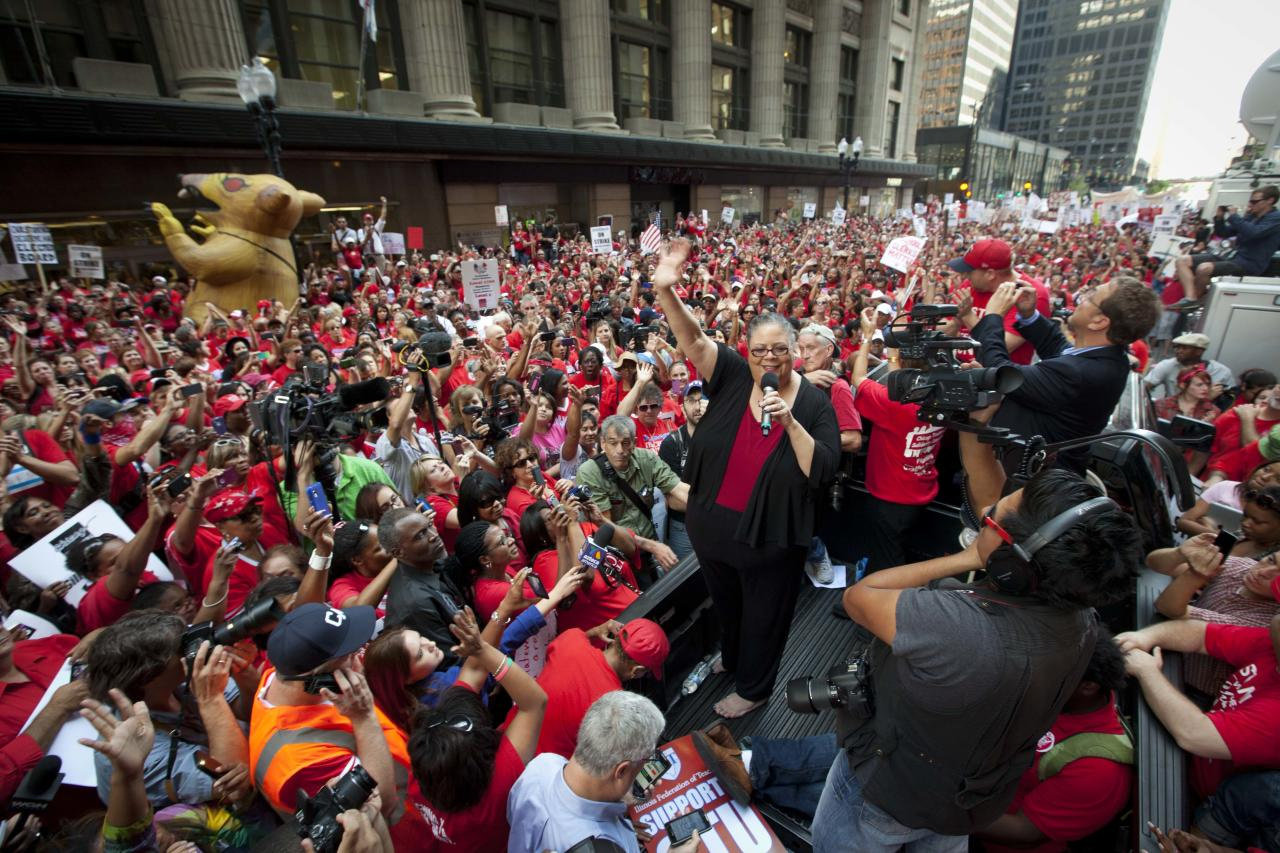 Chicago Teachers Union President Karen Lewis takes a break from negotiations over teachers' contracts with the Chicago Board of Education to address a rally of thousands of public school teachers on Tuesday, Sept. 11, 2012 in downtown Chicago. Teachers walked off the job Monday for the first time in 25 years over issues that include pay raises, classroom conditions, job security and teacher evaluations. (AP Photo/Sitthixay Ditthavong)