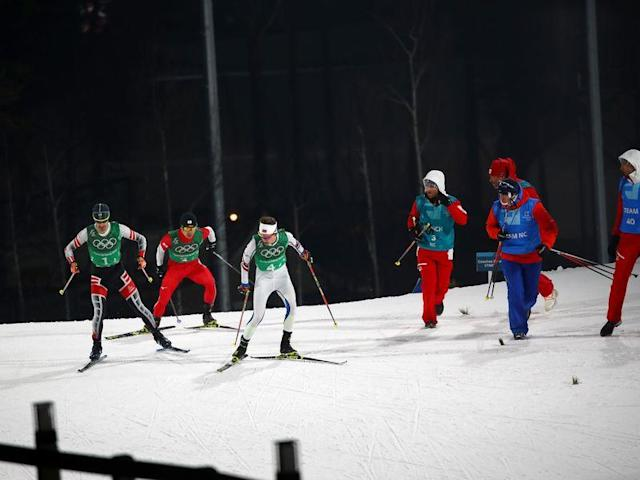 Nordic Combined Events - Pyeongchang 2018 Winter Olympics - Men's Team 4 x 5 km Final - Alpensia Cross-Country Skiing Centre - Pyeongchang, South Korea - February 22, 2018 - Lukas Klapfer of Austria, Hideaki Nagai of Japan and Espen Andersen of Norway compete. REUTERS/Carlos Barria