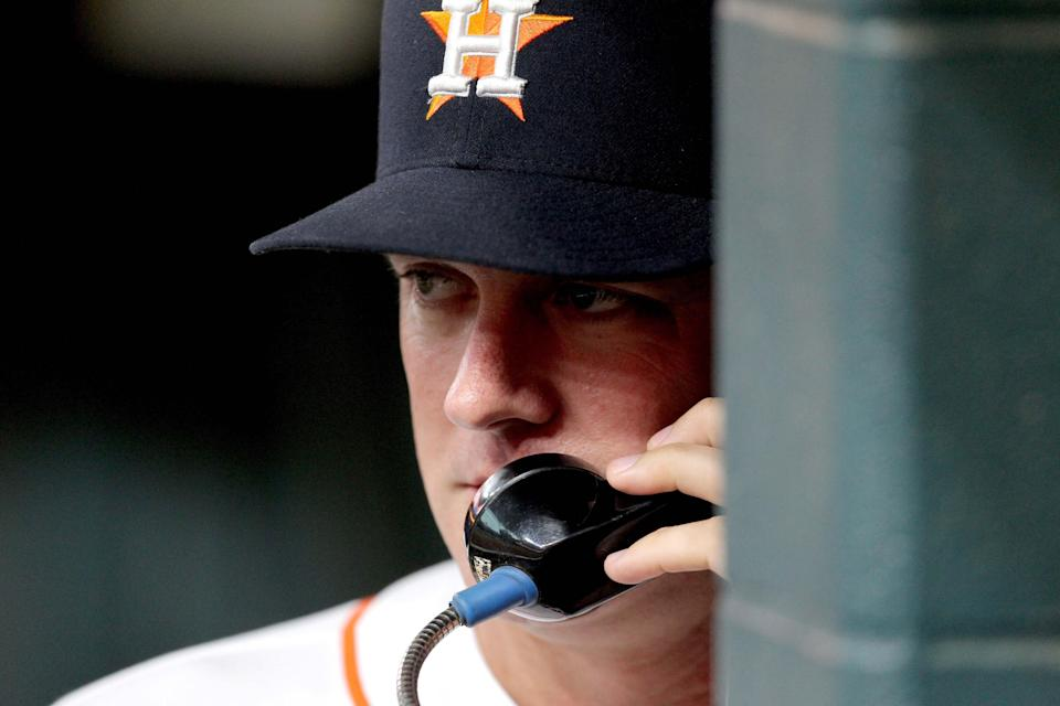 Houston Astros manager A.J. Hinch on the phone prior to a game against the Chicago White Sox at Minute Maid Park, Sept. 20, 2017.