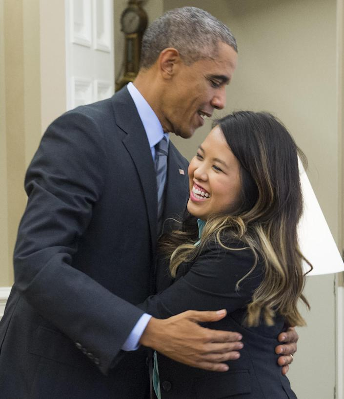 US President Barack Obama hugs nurse Nina Pham, who was declared free of Ebola after contracting the disease while caring for a Liberian patient in Texas, at the White House on October 24, 2014 (AFP Photo/Saul Loeb)