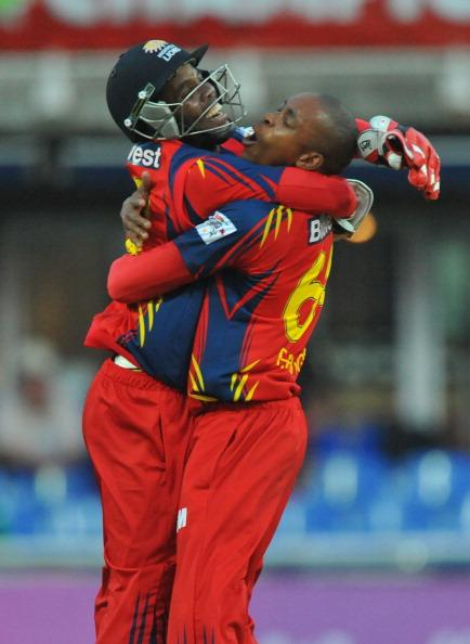 JOHANNESBURG, SOUTH AFRICA - OCTOBER 14:  Thami Tsolekile and Aaron Phangiso of the Lions celebrate the wicket of Sachin Tendulkar of Mumbai for 16 runs during the Karbonn Smart CLT20 match between bizhub Highveld Lions and Mumbai Indians at Bidvest Wanderers Stadium on October 14, 2012 in Johannesburg, South Africa. (Photo by Duif du Toit / Gallo Images/Getty Images)