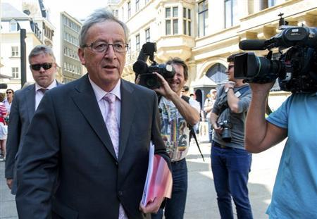 Luxembourg's PM Juncker leaves a meeting with Grand Duke Henri in Luxembourg
