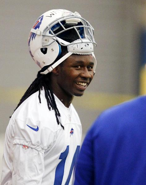Buffalo Bills first-round draft pick Sammy Watkins smiles after taking part in drills during their NFL football rookie camp at the team's facility, Saturday, May 17, 2014, in Orchard Park, N.Y. (AP Photo/Bill Wippert)