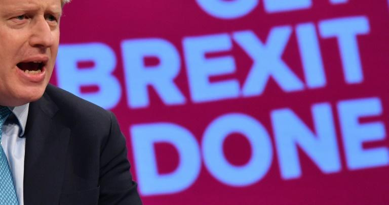 Johnson is obliged by law to seek an extension to Britain's Brexit date if he fails to agree a deal with the EU (AFP Photo/Ben STANSALL)