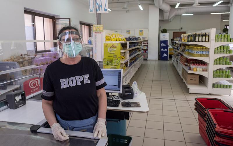 A volunteer cashier works at the emporium of solidarity of the diocesan Caritas of Rome to Casilino Bridge, a supermarket for families in need - Corbis News