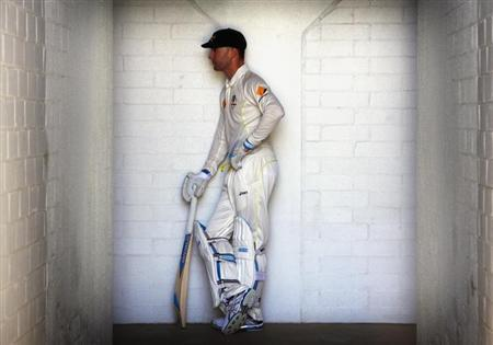 Australia's captain Michael Clarke poses for a photograph in his batting gear after a training session at the WACA ground in Perth December 12, 2013. REUTERS/David Gray