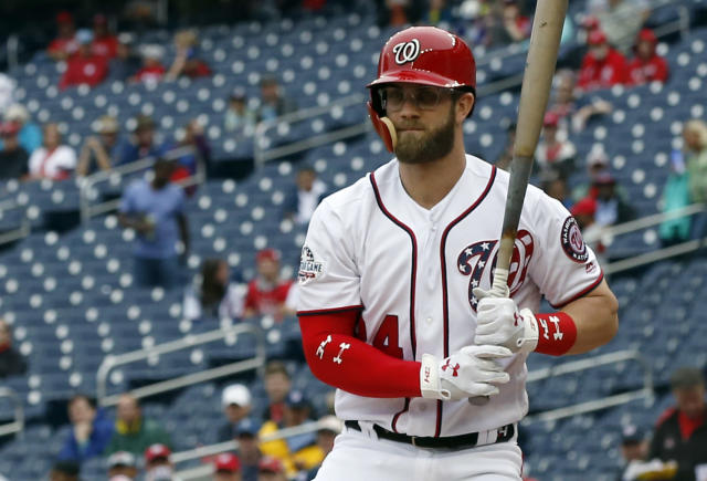 Washington Nationals' Bryce Harper wears glasses to bat during the first inning of the first baseball game of a doubleheader against the Los Angeles Dodgers at Nationals Park, Saturday, May 19, 2018, in Washington. (AP Photo/Alex Brandon)