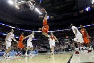 Syracuse guard Brandon Triche (20) elevates toward the basket as Indiana forwards Will Sheehey (0) and Cody Zeller (40) watch during the second half of an East Regional semifinal in the NCAA college basketball tournament, Thursday, March 28, 2013, in Washington. (AP Photo/Pablo Martinez Monsivais)
