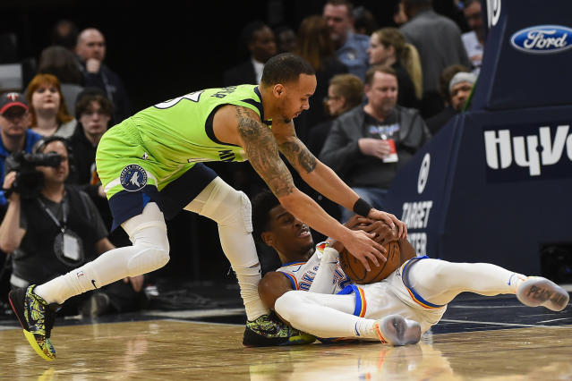 Minnesota Timberwolves guard Shabazz Napier, left, and Oklahoma City Thunder guard Shai Gilgeous-Alexanderfight for a loose ball resulting in a jump ball during the first half of an NBA basketball game Saturday, Jan. 25, 2020, in Minneapolis. (AP Photo/Craig Lassig)