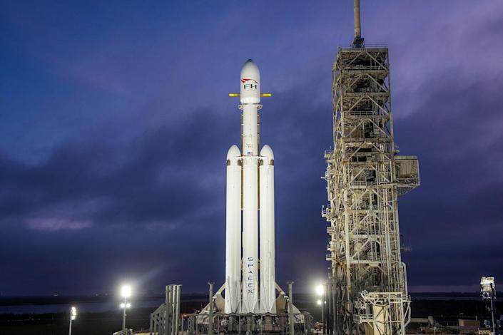SpaceX's first Falcon Heavy rocket stands atop Launch Pad 39A at NASA's Kennedy Space Center in Cape Canaveral, Florida. The rocket's debut launch is scheduled for Feb. 6, 2018. <cite>SpaceX</cite>