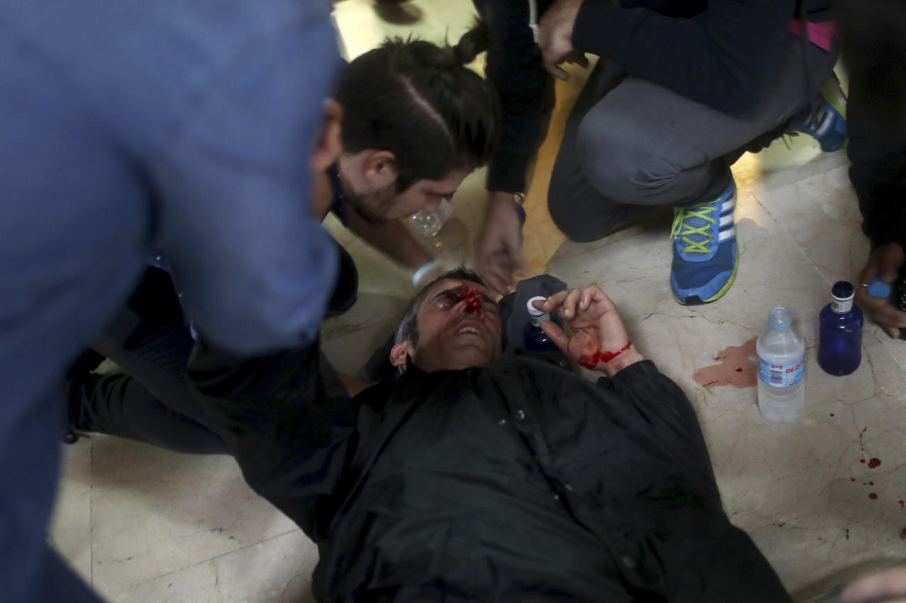 <p>A protester is attended after being hit by a rubber bullet shot by Spanish National Police near a polling station. (AP) </p>