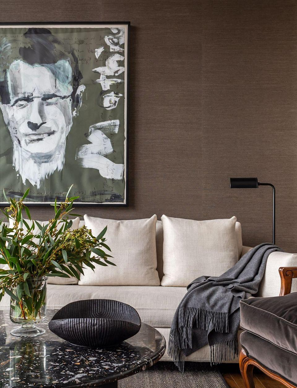 """<p>""""The color is so handsome and I love the texture it brings to the space,"""" says Whitney Ray, principal at Wyeth Ray Interiors. """"The grasscloth is a perfect backdrop for the artwork, but also helps the room to feel more intimate."""" Here, this living space is swatched in Phillip Jeffries' """"Manila Hemp"""" in Mink Brown.</p>"""