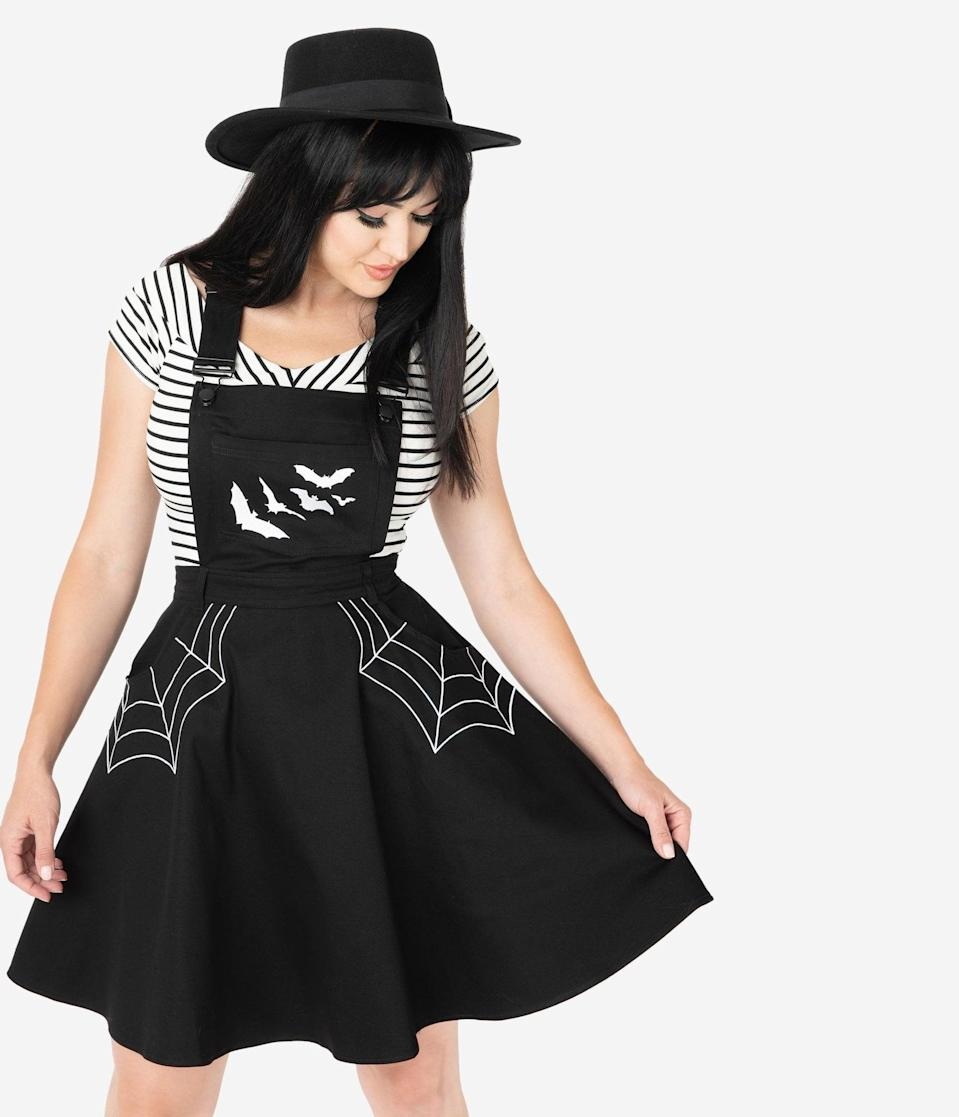 <p>Scare off mortals with this decorative <span>Hell Bunny Black Spiderweb and Bats Miss Muffet Pinafore Dress</span> ($78).</p>