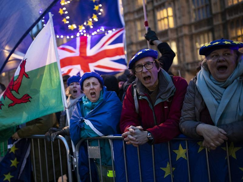 Anti-Brexit protesters demonstrate outside the Houses of Parliament: Getty