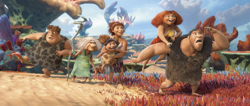 """This film publicity image released by DreamWorks Animation shows, from left, Thunk, voiced by Clark Duke, Gran, voiced by Cloris Leachman, Ugga, voiced by Catherine Keener, who is holding Sandy, voiced by Randy Thom, Eep, voiced by Emma Stone and Grug, voiced by Nicolas Cage, in a scene from """"The Croods."""" (AP Photo/DreamWorks Animation)"""