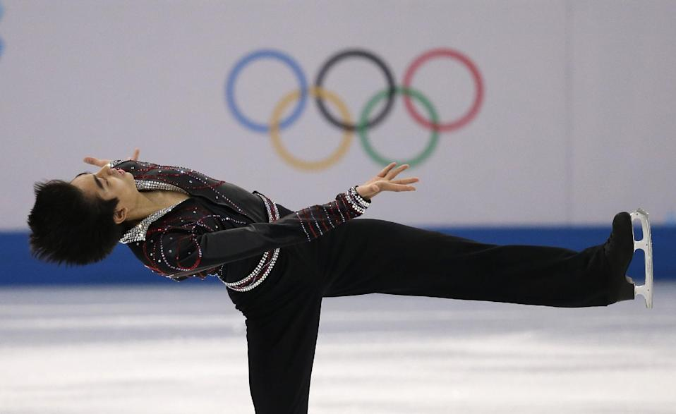 Michael Christian Martinez of the Philippines competes in the men's free skate figure skating final at the Iceberg Skating Palace during the 2014 Winter Olympics, Friday, Feb. 14, 2014, in Sochi, Russia. (AP Photo/Darron Cummings)