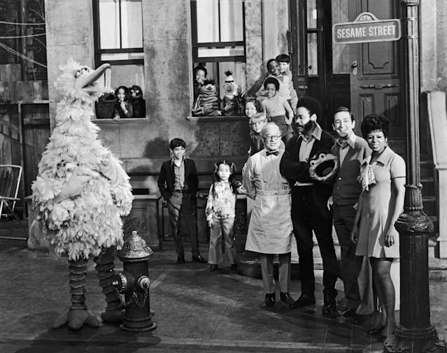 Cast members of <em>Sesame Street</em> posing on the set with some of the puppet characters, 1969. Left to right: Will Lee, Matt Robinson, Bob McGrath and Loretta Long with (left to right) Big Bird, Cookie Monster, Grover, Ernie, Bert and Oscar the Grouch. (Photo: Hulton Archive/Getty Images)