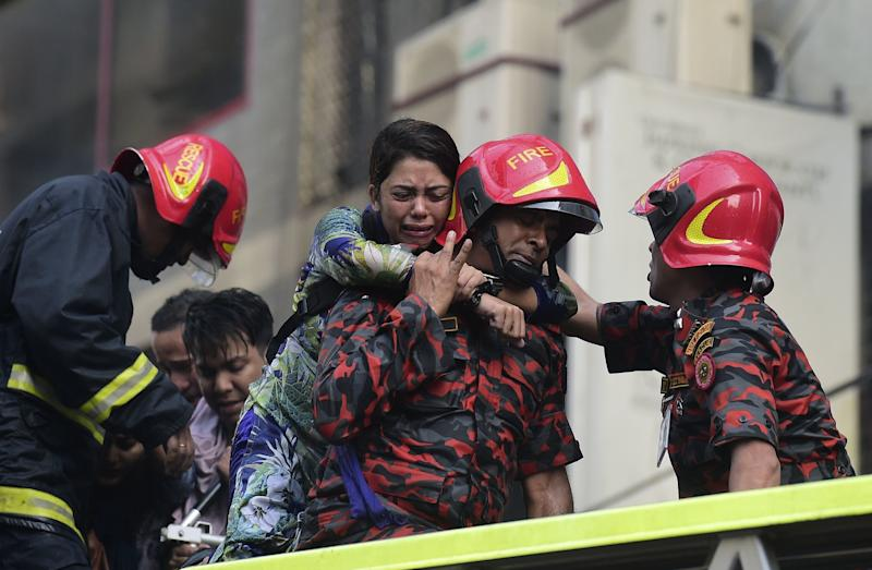 A Bangladeshi survivor reacts after being rescued by firefighters from a burning office building in Dhaka on March 28, 2019. (Photo: Munir Uz Zaman/AFP/Getty Images)