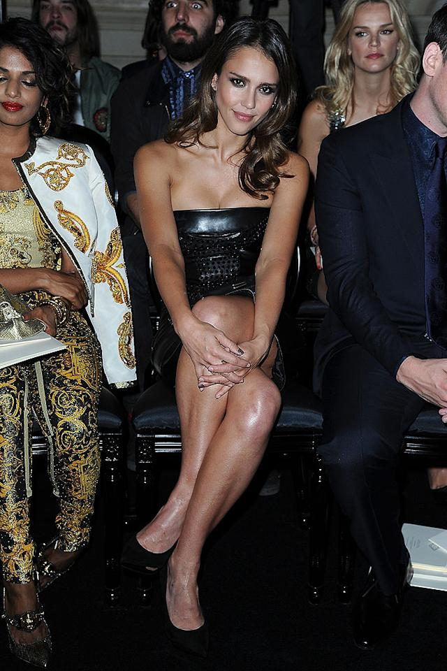 Jessica Alba looked like one hot mama in her black leather strapless dress at the Versace Haute-Couture show, which took place at the Ritz Paris on Sunday. She may have been busy posing for the cameras, but the guy behind her clearly couldn't take his eyes of the runway. (7/1/2012)