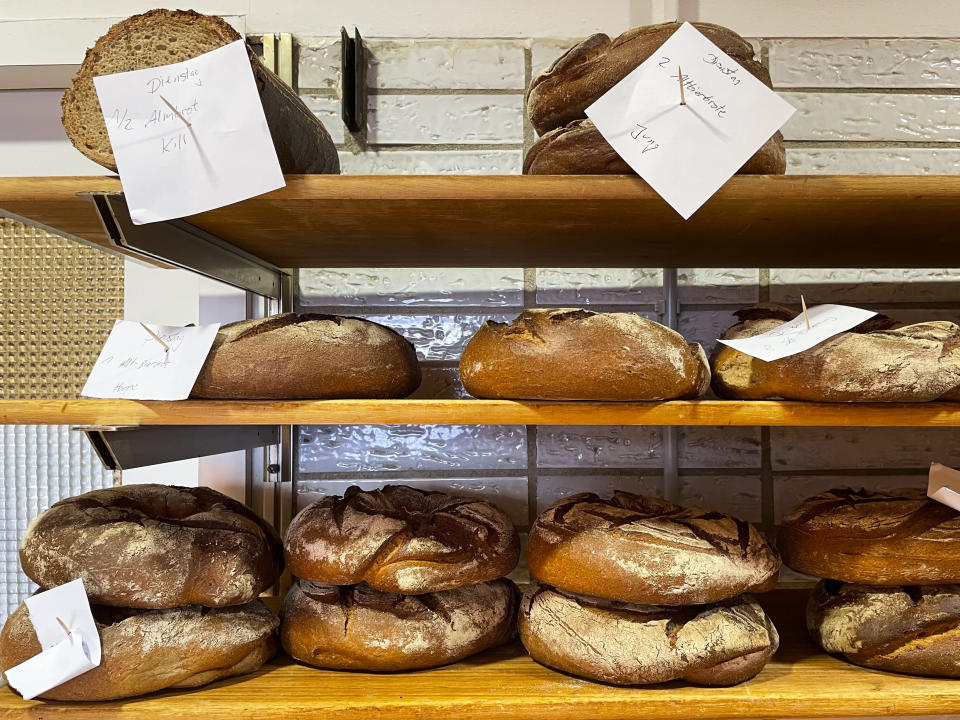 Bread that was baked with beer is displayed at the Coelven bakery in Duesseldorf, Germany, Tuesday, March 23, 2021. The historic Fuechschen brewery in Duesseldorf, has about 6,000 litres of its renowned copper-colored 'Altbier' unsold and nearing its expiry date. The brewery is now working with craft bakers who use the beer to make bread, with about twelve bakeries producing the grain bread and are giving the additional bonus of a bottle of Fuechschen's Altbier free of charge with every loaf.(AP Photo/Daniel Niemann)