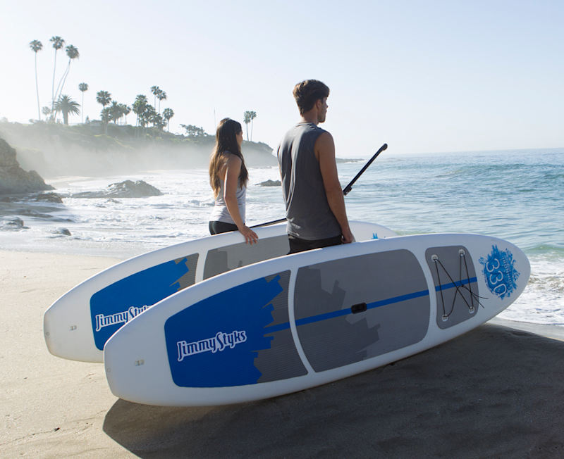 Couple with stand-up paddle boards