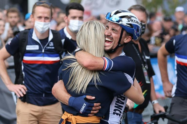 Julian Alaphilippe celebrates with his companion French former cyclist Marion Rousse (AFP/Kenzo Tribouillard)