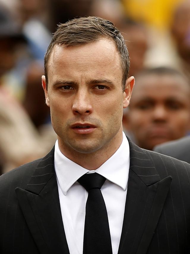 Olympic and Paralympic track star Oscar Pistorius arrives ahead of his trial at the North Gauteng High Court in Pretoria April 9, 2014. Pistorius sobbed in the witness stand on Tuesday as he described how, gripped by fear, he shot dead his girlfriend through a locked toilet door thinking she was an intruder. REUTERS/Siphiwe Sibeko (SOUTH AFRICA - Tags: SPORT ATHLETICS CRIME LAW HEADSHOT)