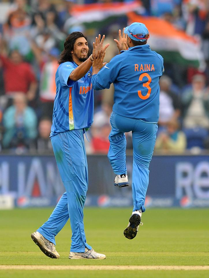 India's Ishant Sharma celebrates taking the wicket of Sri Lanka's Thisara Perera (not pictured) with team mate Suresh Raina (right) during the ICC Champions Trophy, Semi Final at the SWALEC Stadium, Cardiff.
