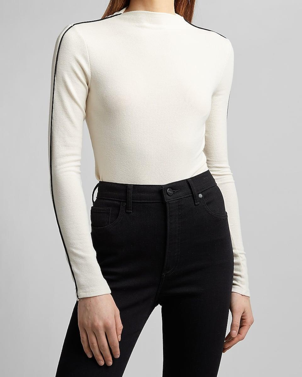 <p>We love the details of this <span>Tipped Sleeve Mock Neck Tee</span> ($58). Minimalists will love this.</p>