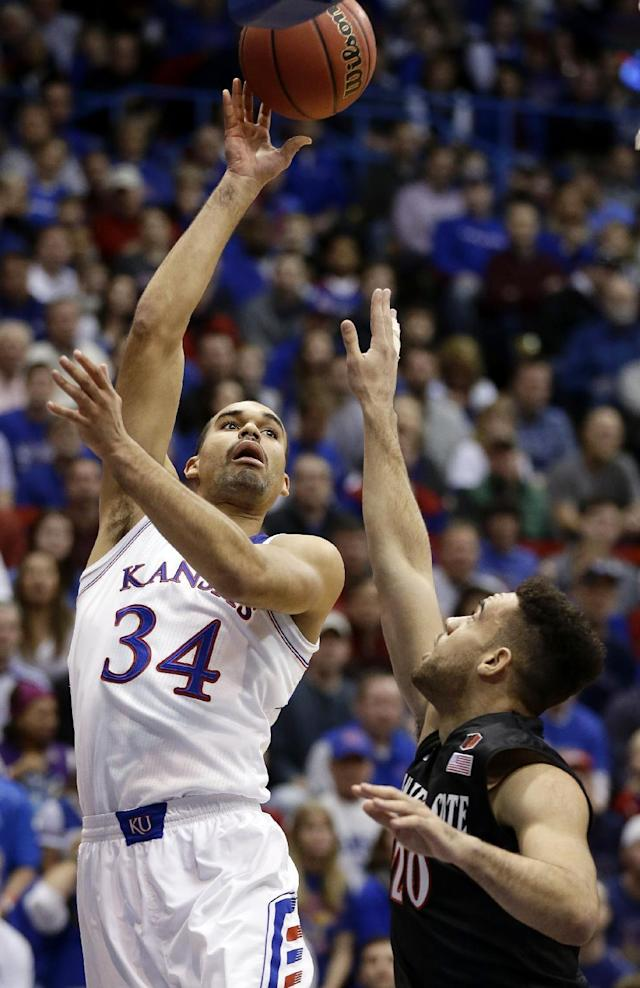 Kansas' Perry Ellis (34) shoots over San Diego State's JJ O'Brien (20) during the first half of an NCAA college basketball game Sunday, Jan. 5, 2014, in Lawrence, Kan. (AP Photo/Charlie Riedel)