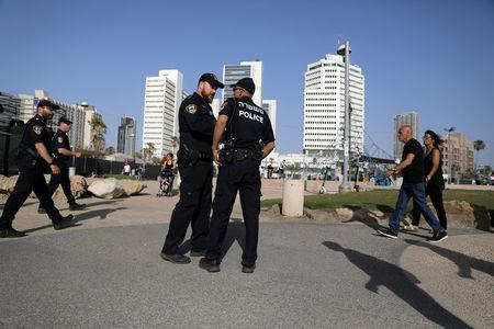 Israeli policemen secure the area near the beach on the eve of the 2019 Eurovision song contest final in Tel Aviv