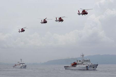 Taiwan Coast Guard patrol ships and helicopters from National Airborne Service Corps are seen during a drill held about 4 nautical miles out of the port of Kaohsiung, southern Taiwan, June 6, 2015. REUTERS/Pichi Chuang