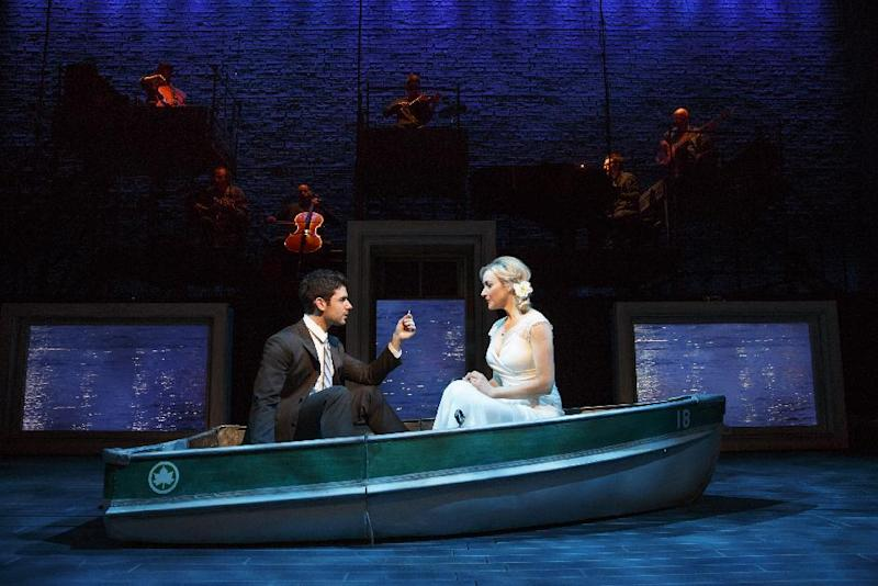 """This theater image released by The Hartman group shows Adam Kantor, left, and Betsy Wolfe during a performance of """"The Last Five Years,"""" in New York. A revival of Jason Robert Brown's song cycle about a troubled marriage was a highlight of Second Stage Theatre's last season. (AP Photo/The Hartman Group, Joan Marcus)"""