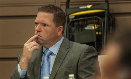 Former Fullerton police officer Jay Cicinelli listens to the opening statements of John Barnett in Santa Ana