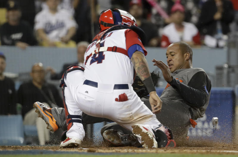 Puerto Rico catcher Yadier Molina, left, tags out Netherlands' Jonathan Schoop, who tried to score on a hit by Shawn Zarraga during the fifth inning of a semifinal in the World Baseball Classic in Los Angeles, Monday, March 20, 2017. (AP Photo/Chris Carlson)
