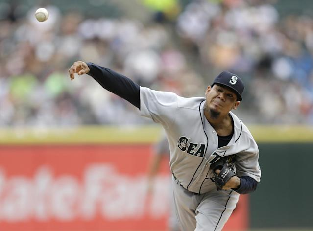 Seattle Mariners starter Felix Hernandez throws against the Chicago White Sox during the first inning of a baseball game in Chicago on Saturday, July 5, 2014. (AP Photo/Nam Y. Huh)