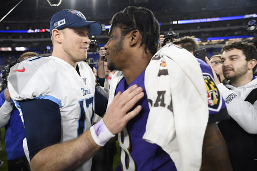 Tennessee Titans quarterback Ryan Tannehill, left, speaks with Baltimore Ravens quarterback Lamar Jackson after an NFL divisional playoff football game, Saturday, Jan. 11, 2020, in Baltimore. The Titans won 28-12. (AP Photo/Nick Wass)
