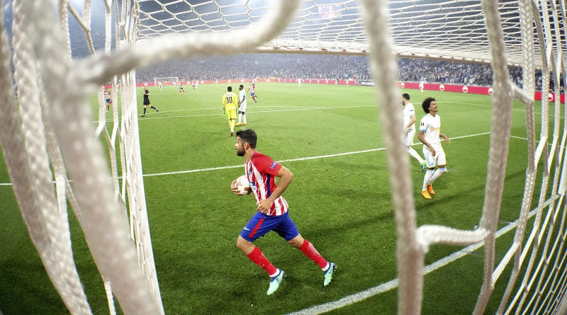 Atletico Madrid's Diego Costa retrieves the ball after Antoine Griezmann scored his side second goal second goal during the Europa League Final soccer match between Marseille and Atletico Madrid at the Stade de Lyon outside Lyon, France, Wednesday, May 16, 2018. (Pawel Kopczynski, Pool via AP)