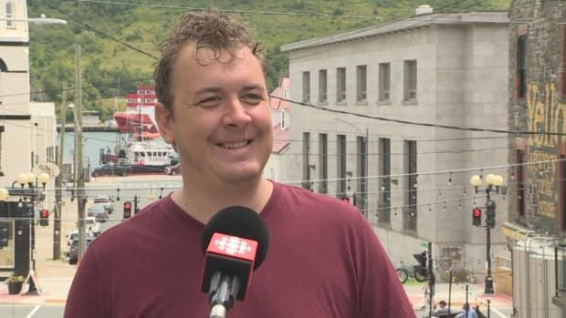Singer-songwriter Chris Ryan says the new loading zones will come in handy for musicians in downtown St. John's. (Emma Grunwald/CBC - image credit)