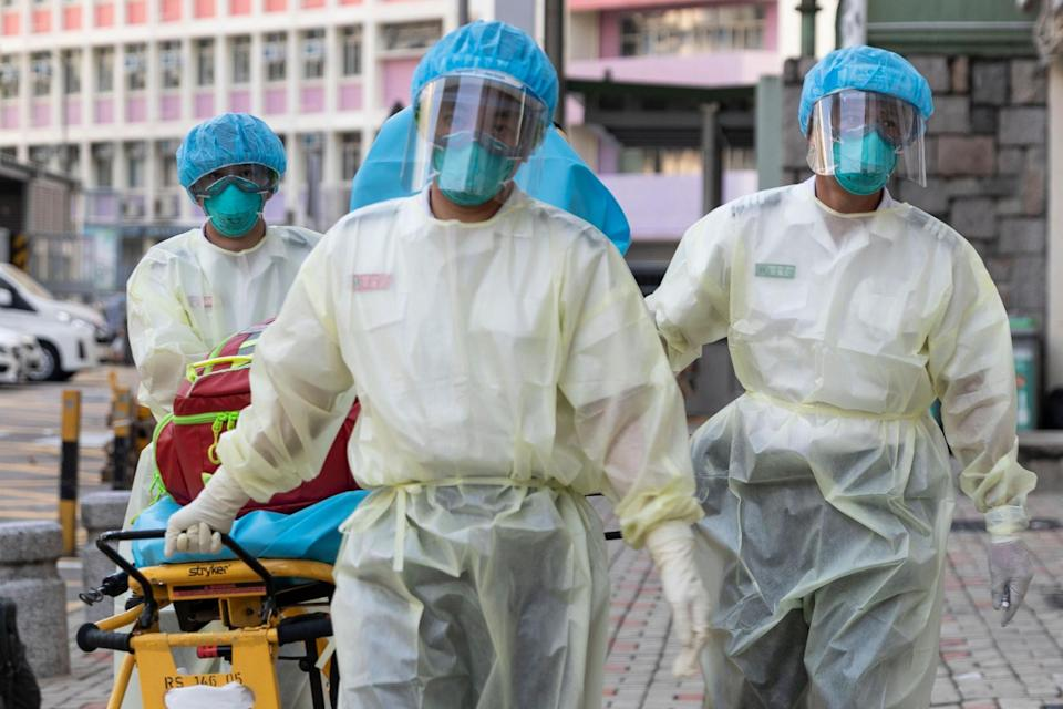 Medical staff wear personal protective equipment as a precautionary measure against coronavirus in Hong Kong: May James/AFP via Getty Images