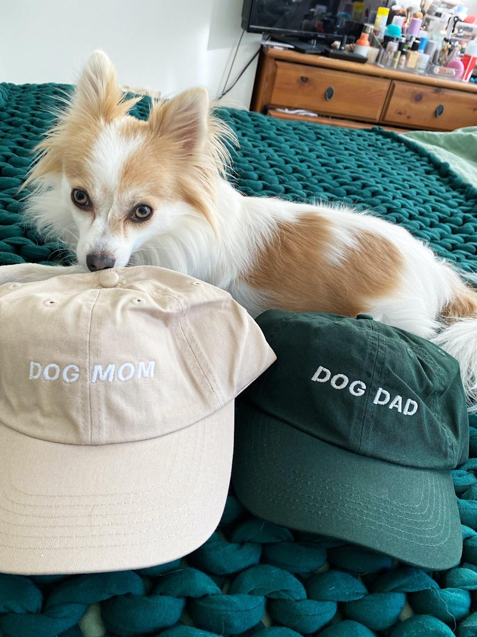 """<h2>Etsy Dog Mom Hat</h2><br>""""Speaking of dog stuff, my heart skipped a beat when I came across this Etsy gem. I loved how I could customize the hat and text color (I went with beige, to match my little one — it's clear he's responding to it), and I was even able to score it on sale. Plus, I couldn't miss the opportunity to surprise my boyfriend with a matching one in the coolest shade of forest green. """" <em>– Karina Hoshikawa, Beauty & Wellness Writer</em><br><br><em>Shop <strong><a href=""""https://www.etsy.com/shop/mallcore"""" rel=""""nofollow noopener"""" target=""""_blank"""" data-ylk=""""slk:mallcore"""" class=""""link rapid-noclick-resp"""">mallcore</a></strong></em><br><br><strong>mallcore</strong> Dog Mom Dad Hat, Dog Lover Gift, Dog Mom Gift, Dog Lover Baseball Hat, Pet Gifts, Pet Lovers Gift, Gift For Dog Lover, $, available at <a href=""""https://go.skimresources.com/?id=30283X879131&url=https%3A%2F%2Fwww.etsy.com%2Flisting%2F607202809%2Fdog-mom-dad-hat-dog-lover-gift-dog-mom"""" rel=""""nofollow noopener"""" target=""""_blank"""" data-ylk=""""slk:Etsy"""" class=""""link rapid-noclick-resp"""">Etsy</a>"""